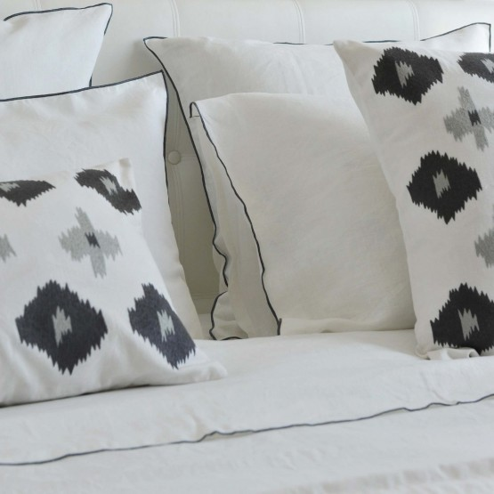 White washed linen pillow case with gray bourdon stitching